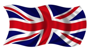 The Flag of the United Kingdom on white background billowing in the wind.